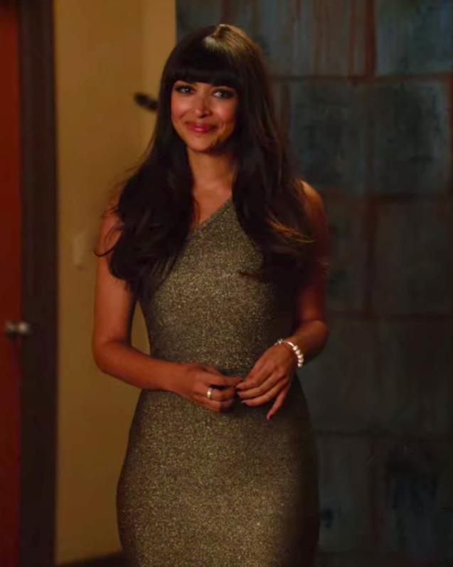 Cece wearing an off-the-shoulder dress