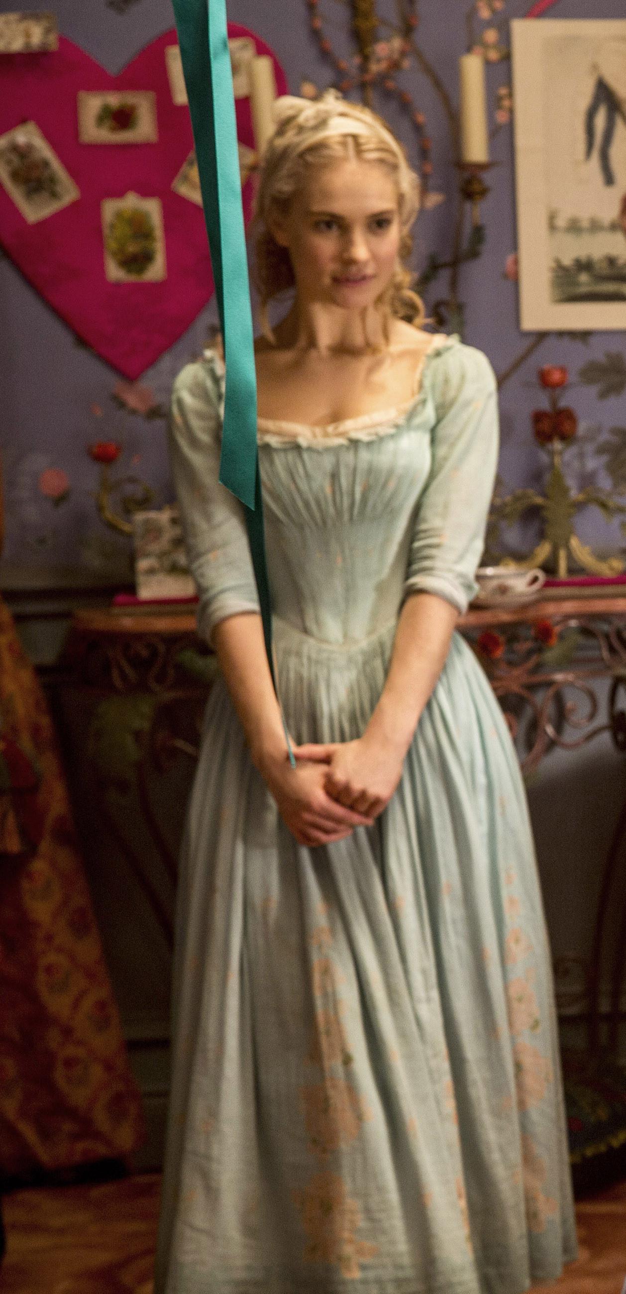 Cinderella wearing a long sleeve dress