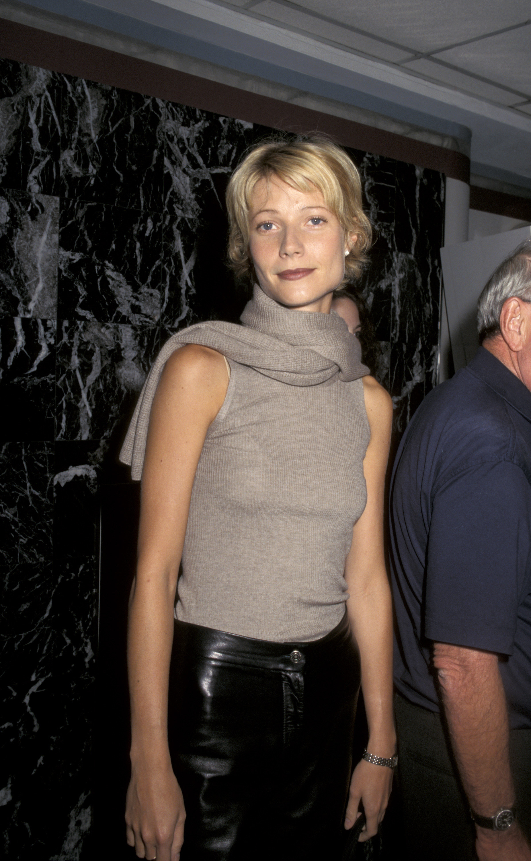 Photo ofGwyneth Paltrow in a neutral tank and black pants