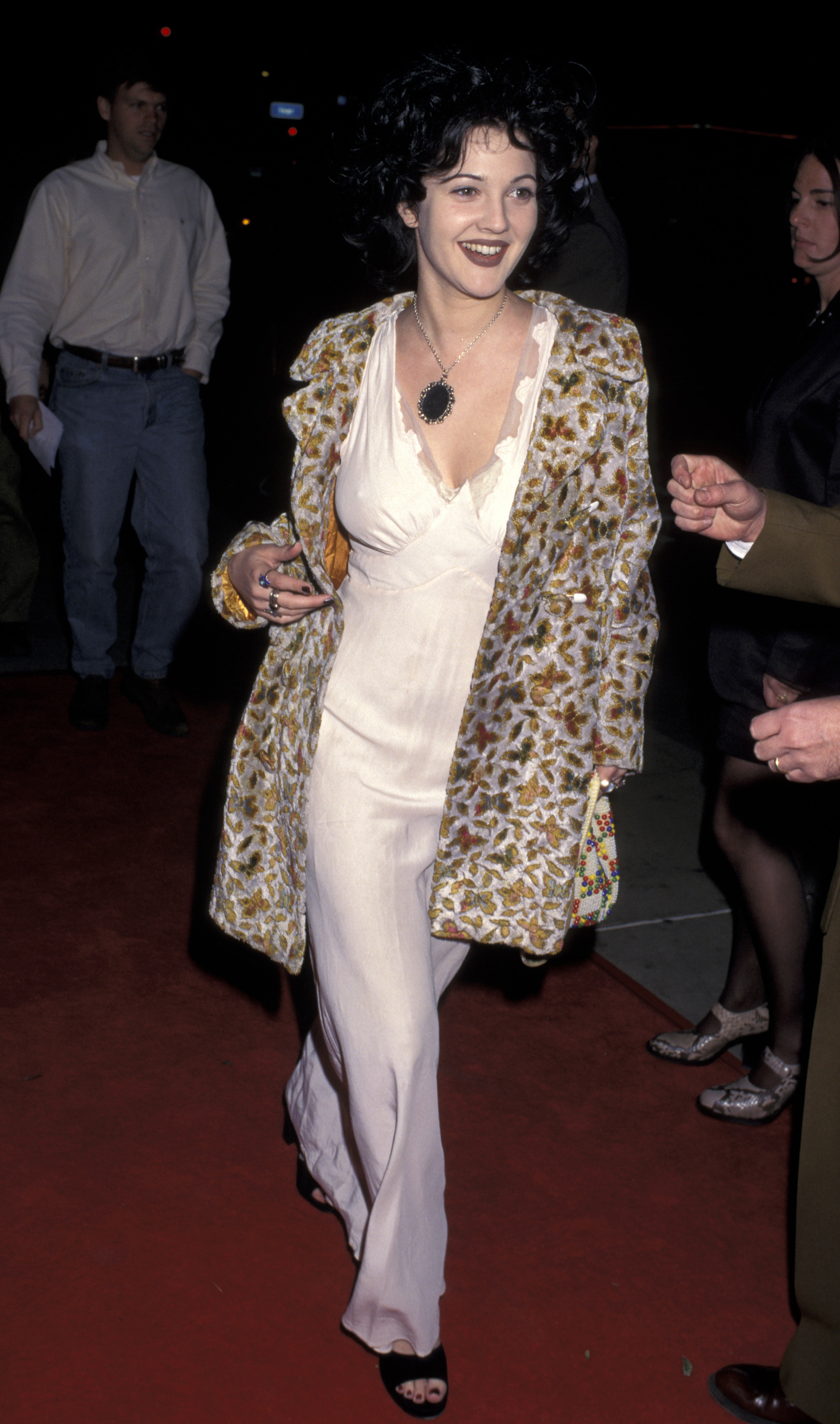 Photo of Drew Barrymore in a long dress and coat