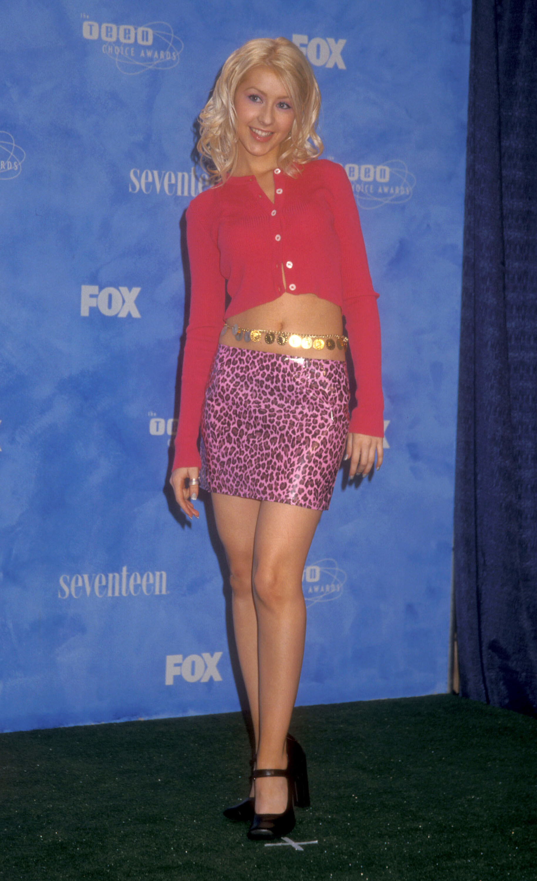 Photo ofChristina Aguilera smiling on at a premiere