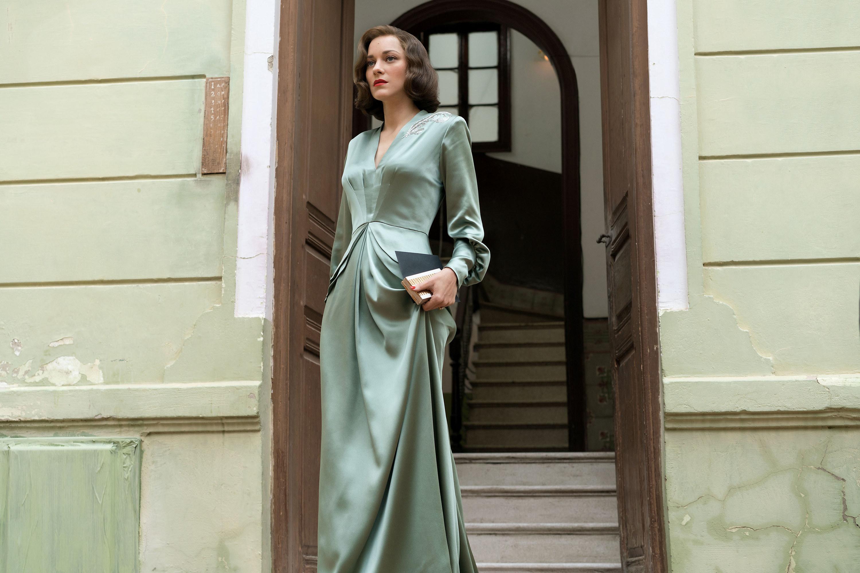 Marianne wearing a long sleeve dress