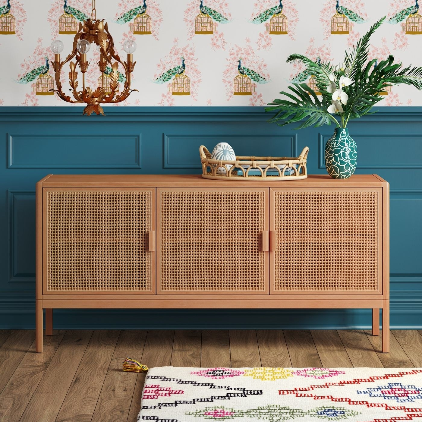 the rattan tv stand in natural brown against a teal wall