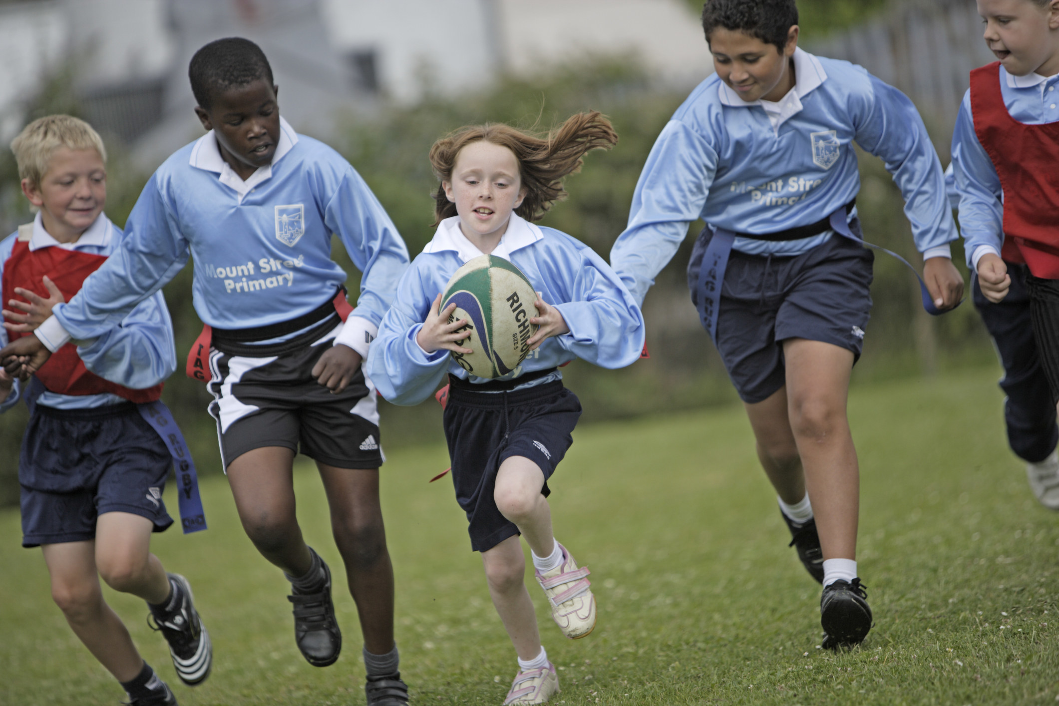 Children playing rugby at school