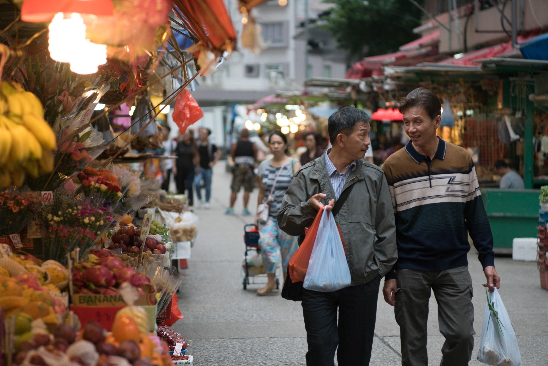 from left: Ben Yuen, Tai-Bo walking outside