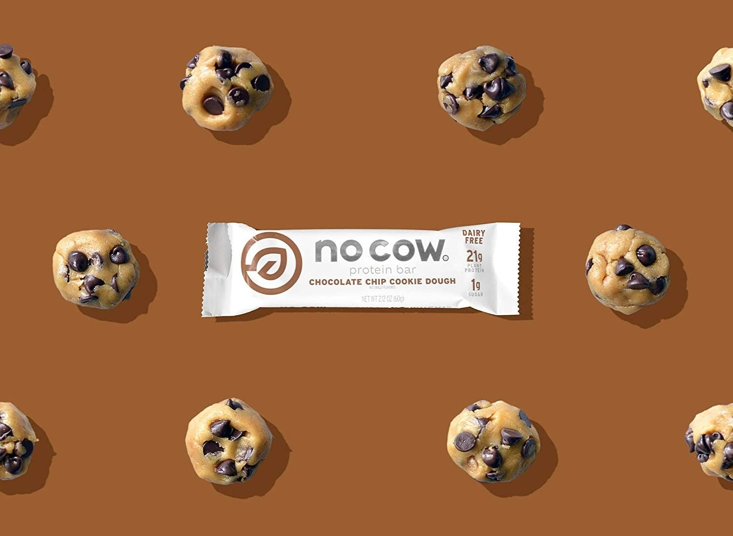 The protein bar on a brown background with cookie dough around it