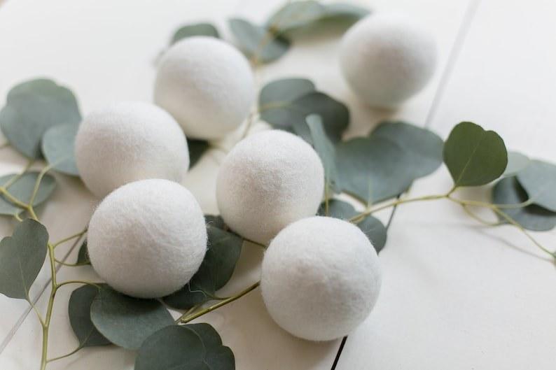 six white dryer balls