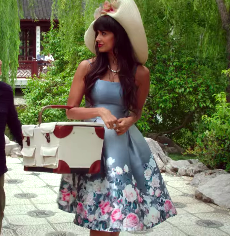 Tahani wearing a fit and flare dress with small straps