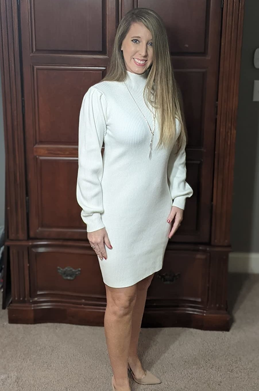 Reviewer wearing the whitelong-sleeve knit turtleneck sweater dress