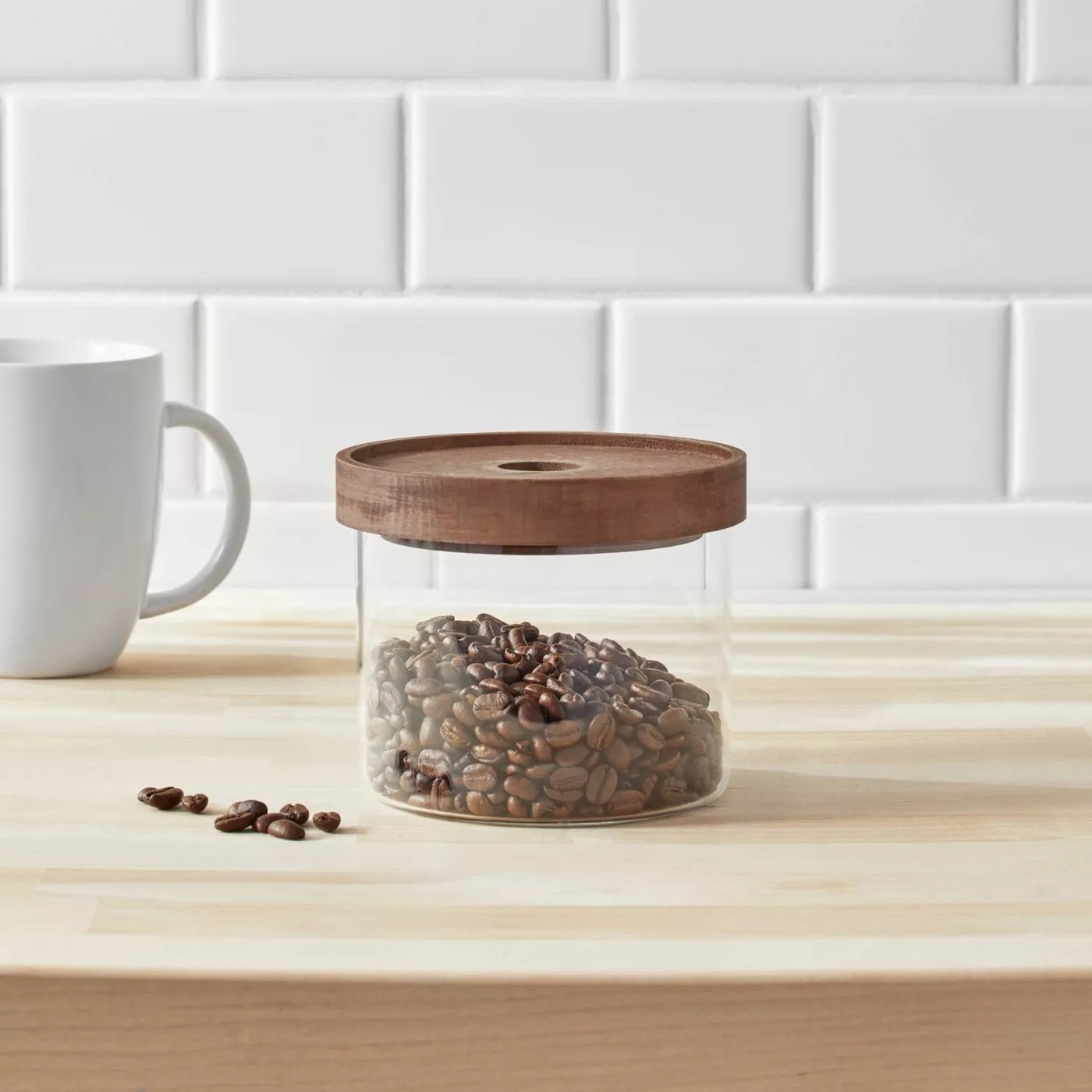The glass container with coffee beans inside