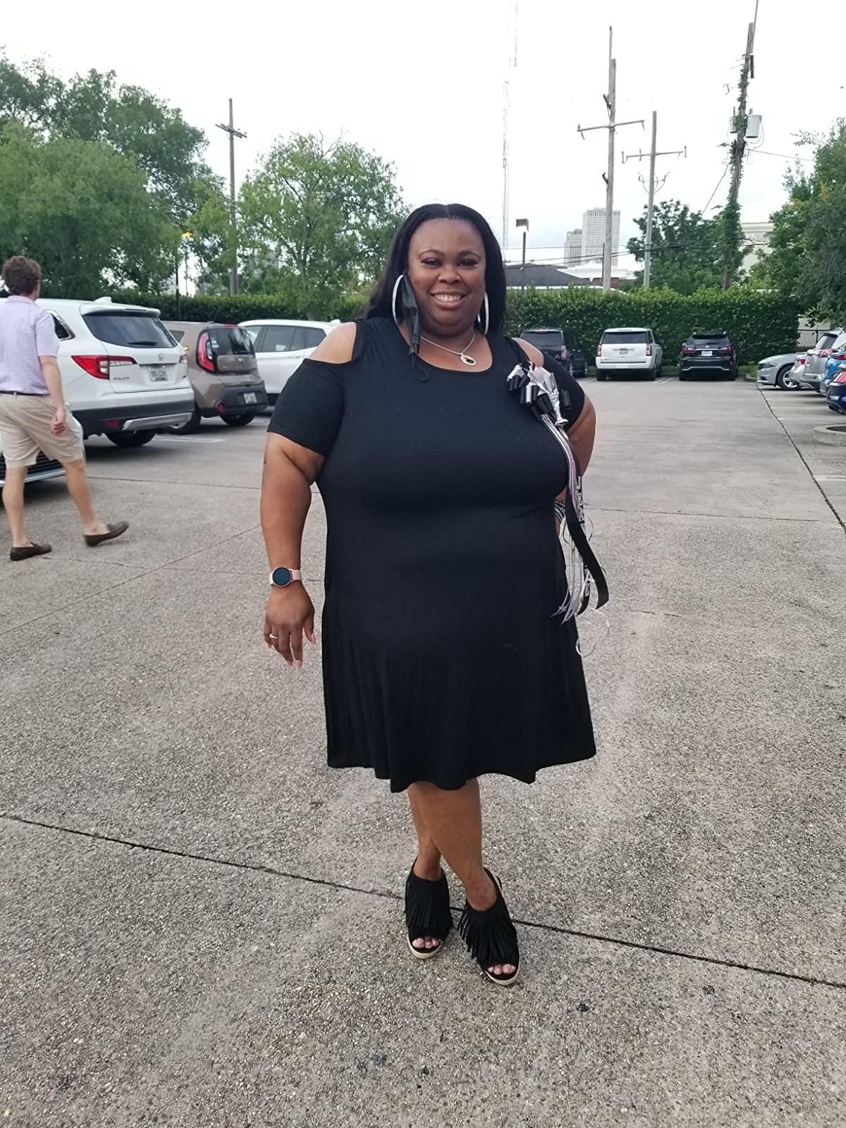 Reviewer wearing the blackshort-sleeve cold shoulder casual t-shirt dress