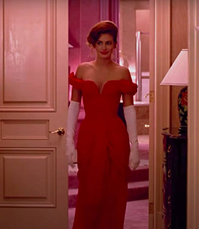 Vivian wearing an off the shoulder gown