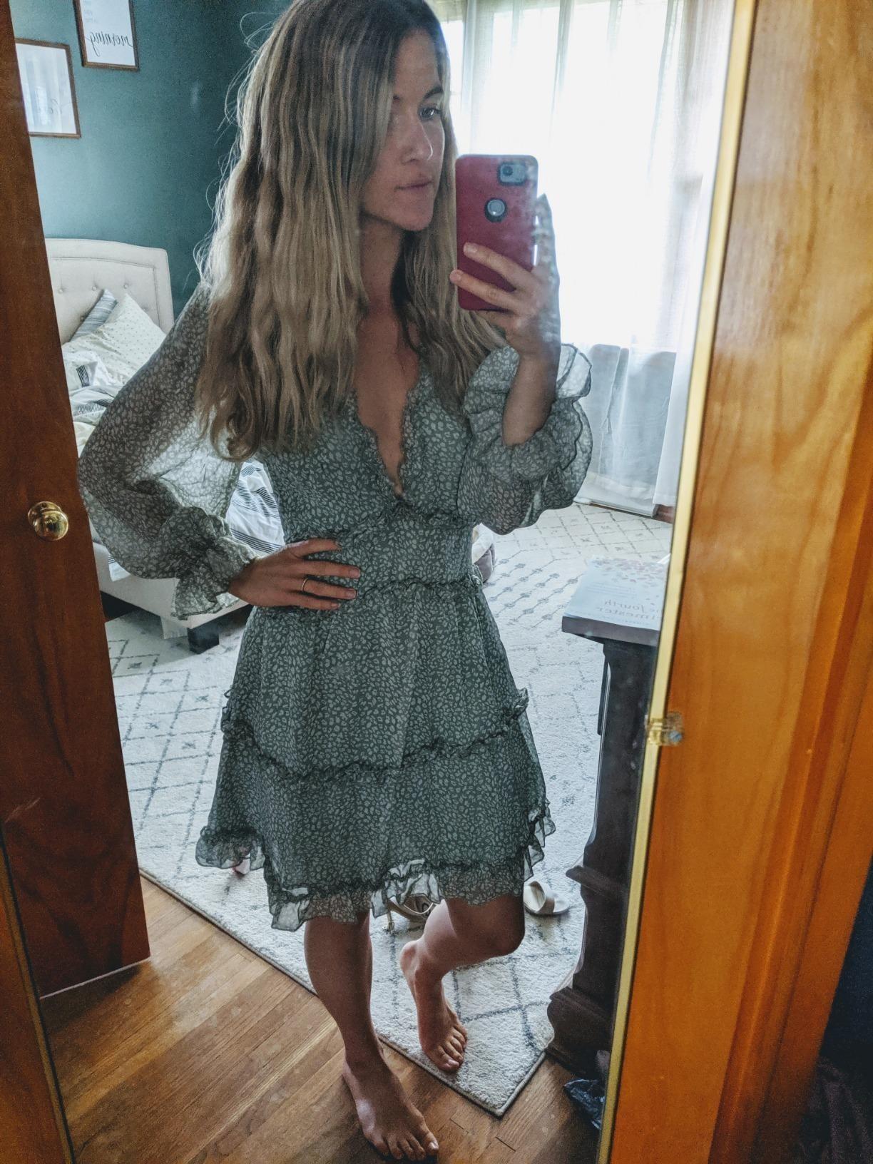 Reviewer wearing the greenlong-sleeve layered ruffle swing dress