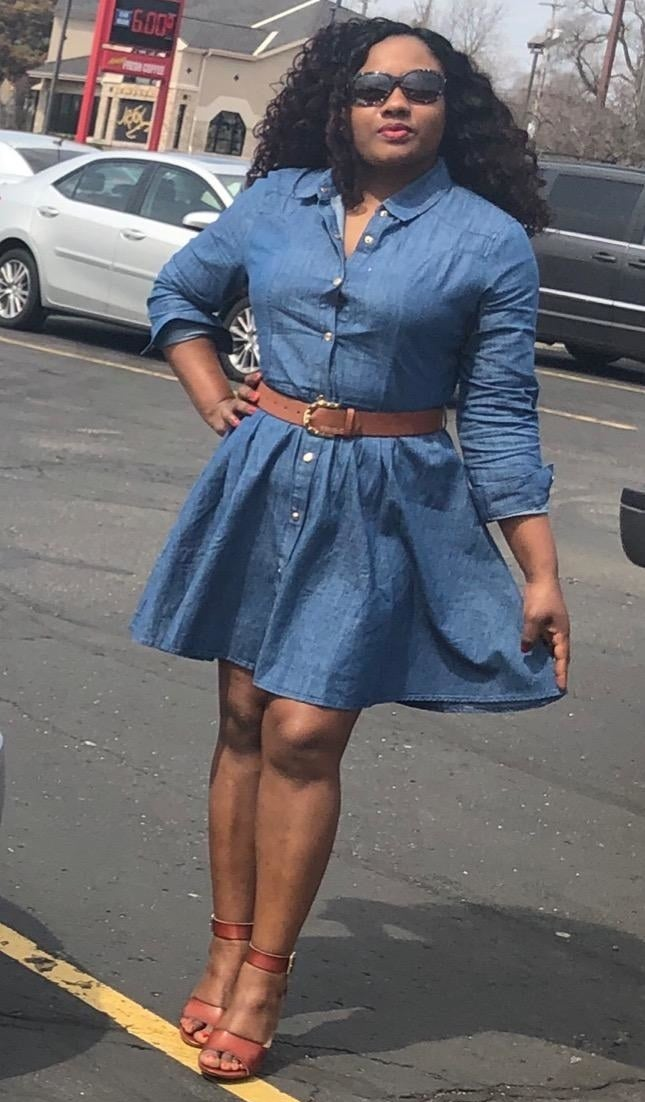 Reviewer wearing the blue belted denim flared shirt dress