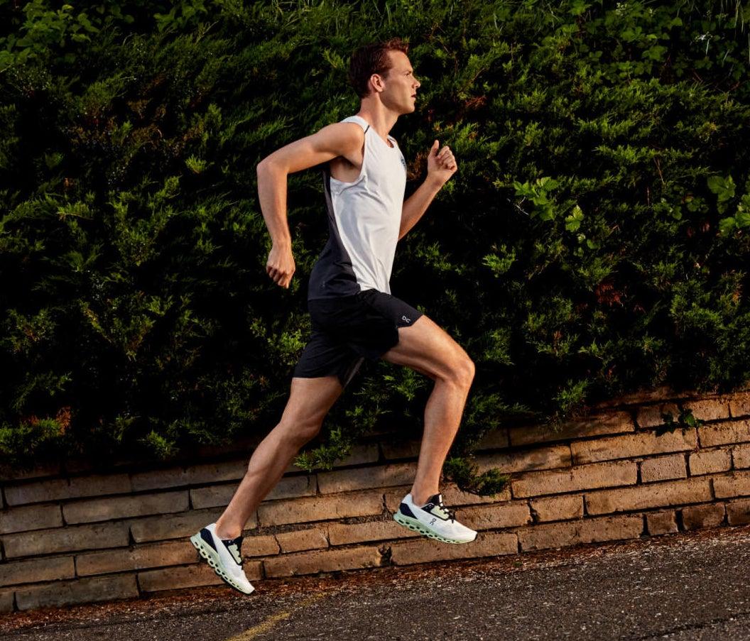 model running in the sneakers in green