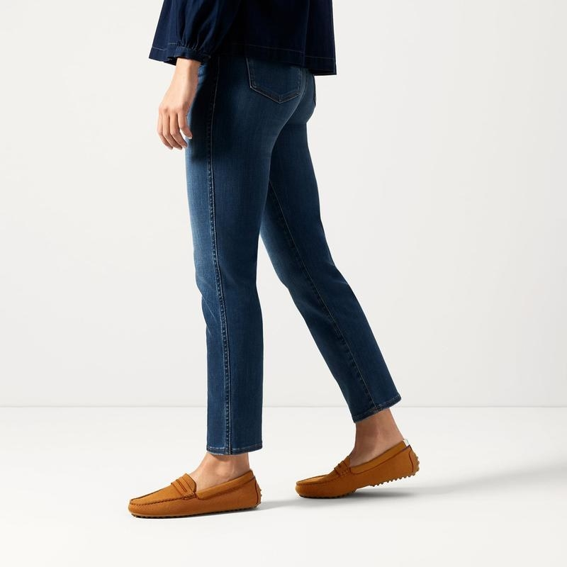 model wearing the tan knit loafers