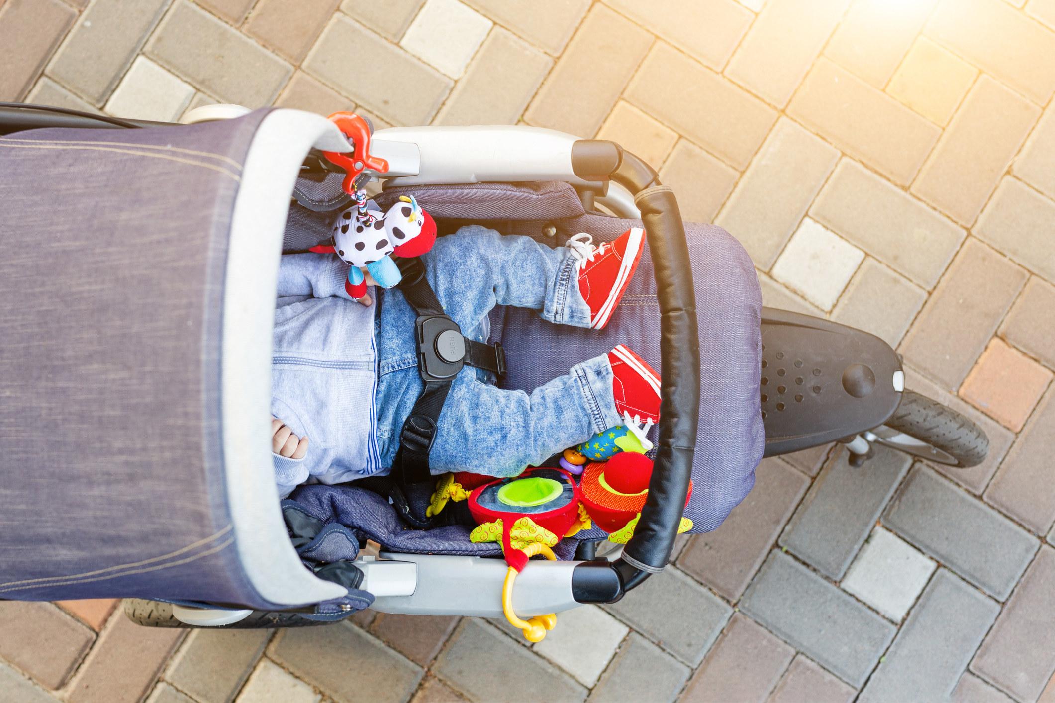 A baby sleeping in a stroller.