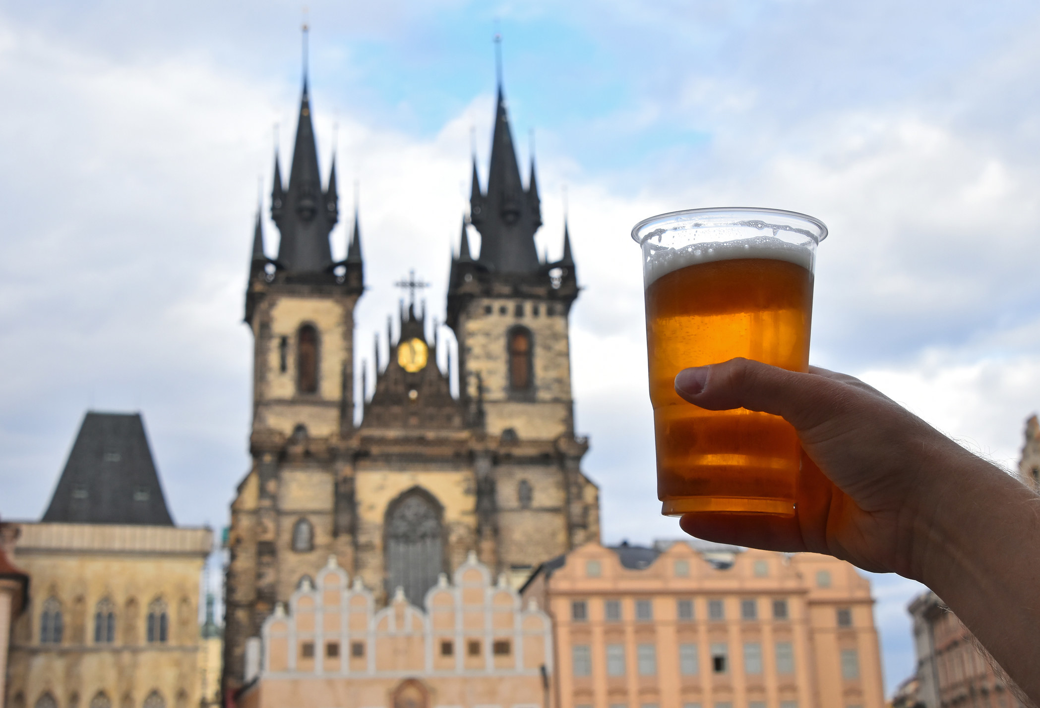Someone holding a beer in Prague.