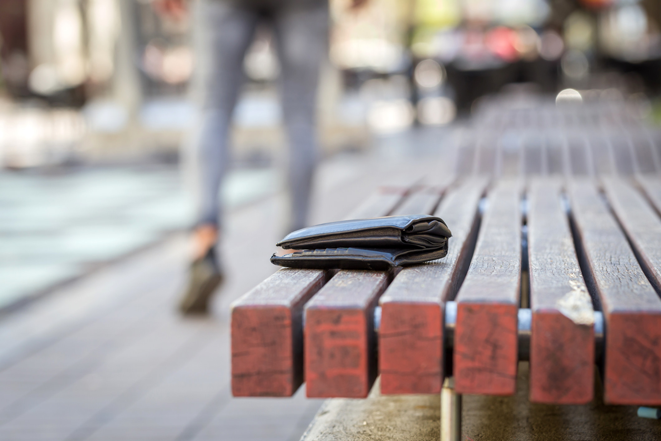 A lost wallet on a bench.