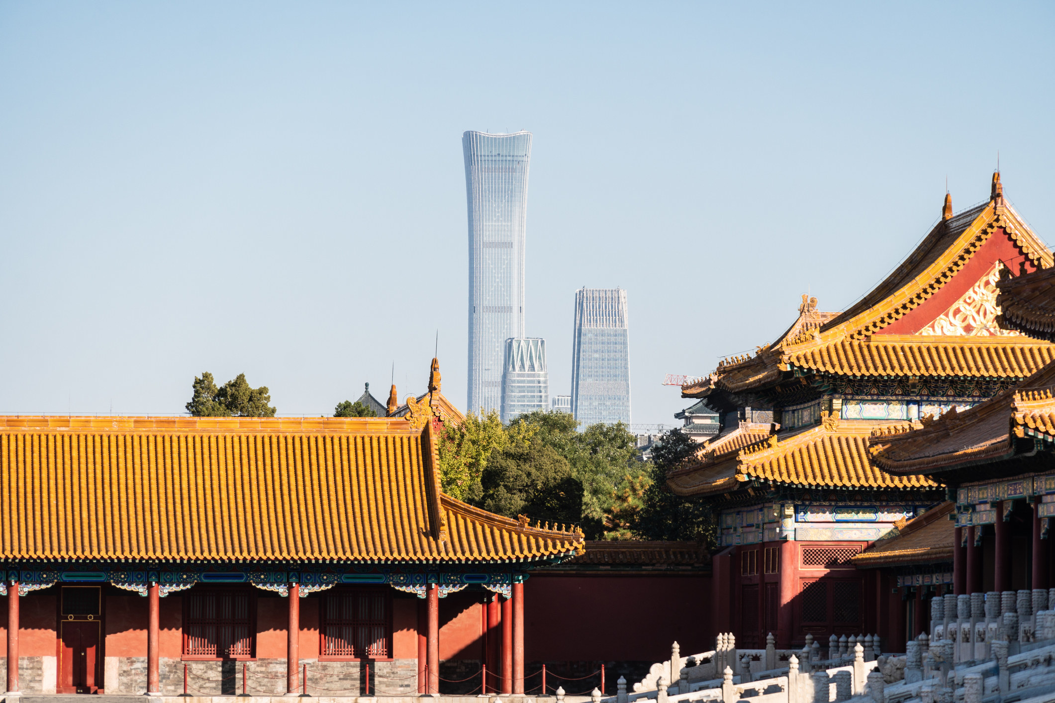 The forbidden city in Beijing and modern buildings in the background.