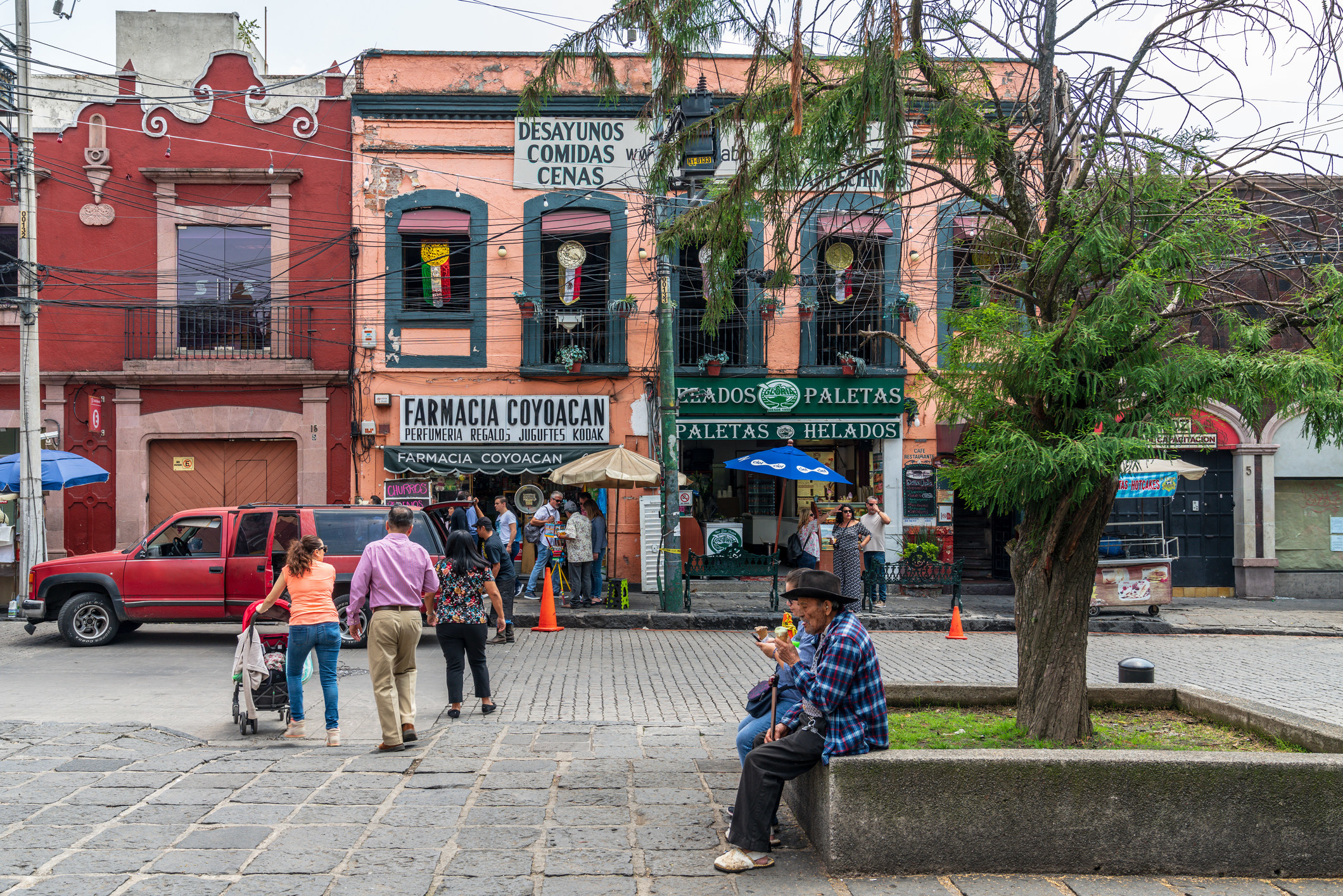 People outside a taqueria in Mexico City.