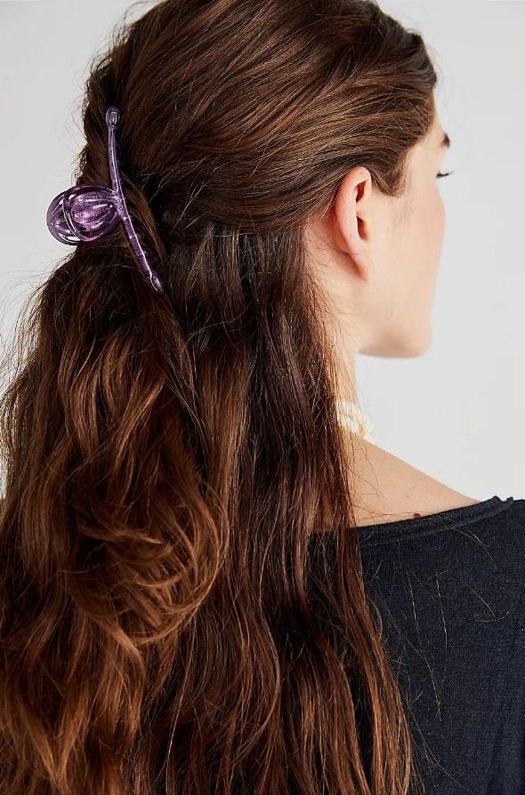 Model wearing purple jaw clip in hair