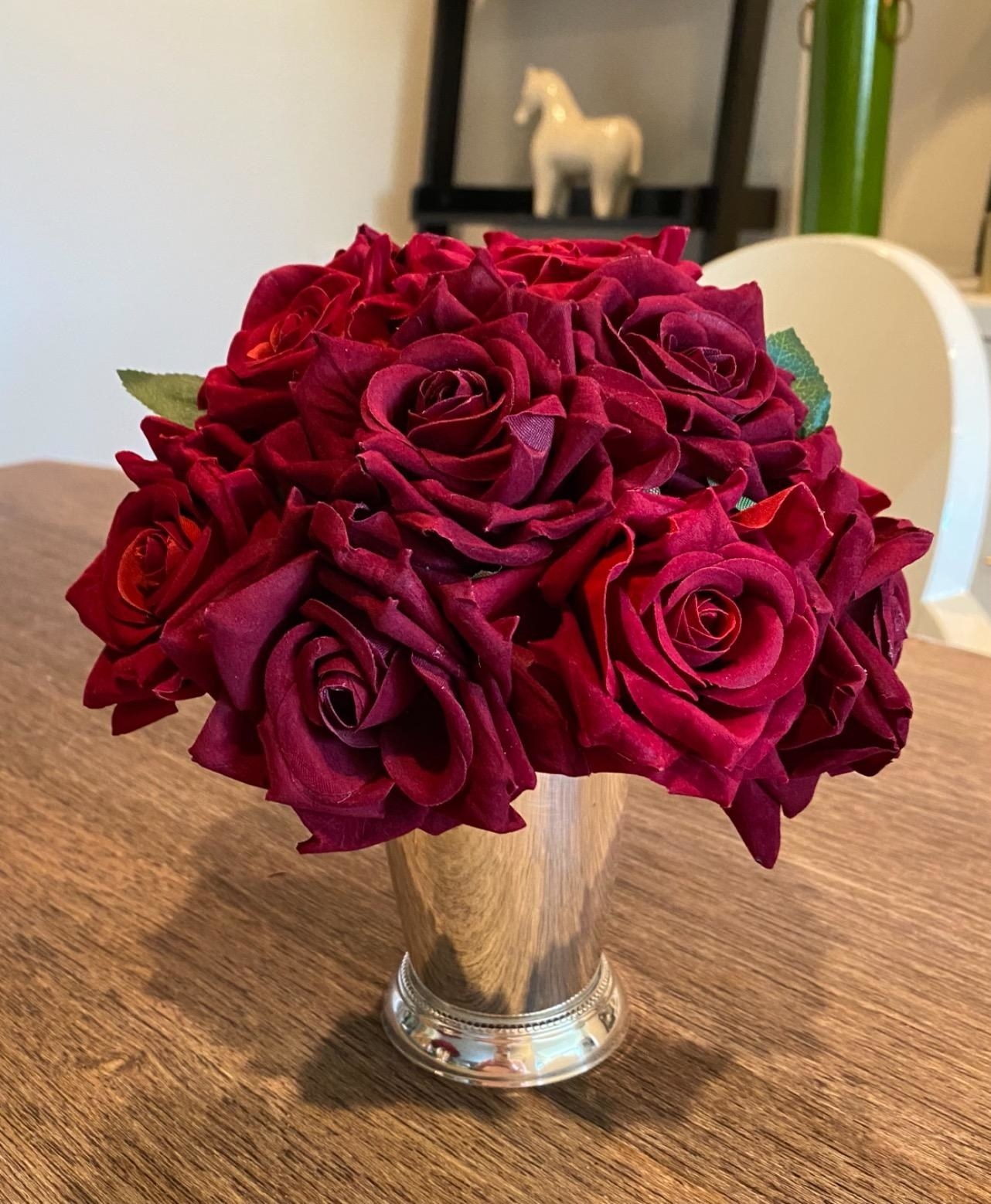 Reviewer's bouquet of faux red roses are arranged in a silver vase