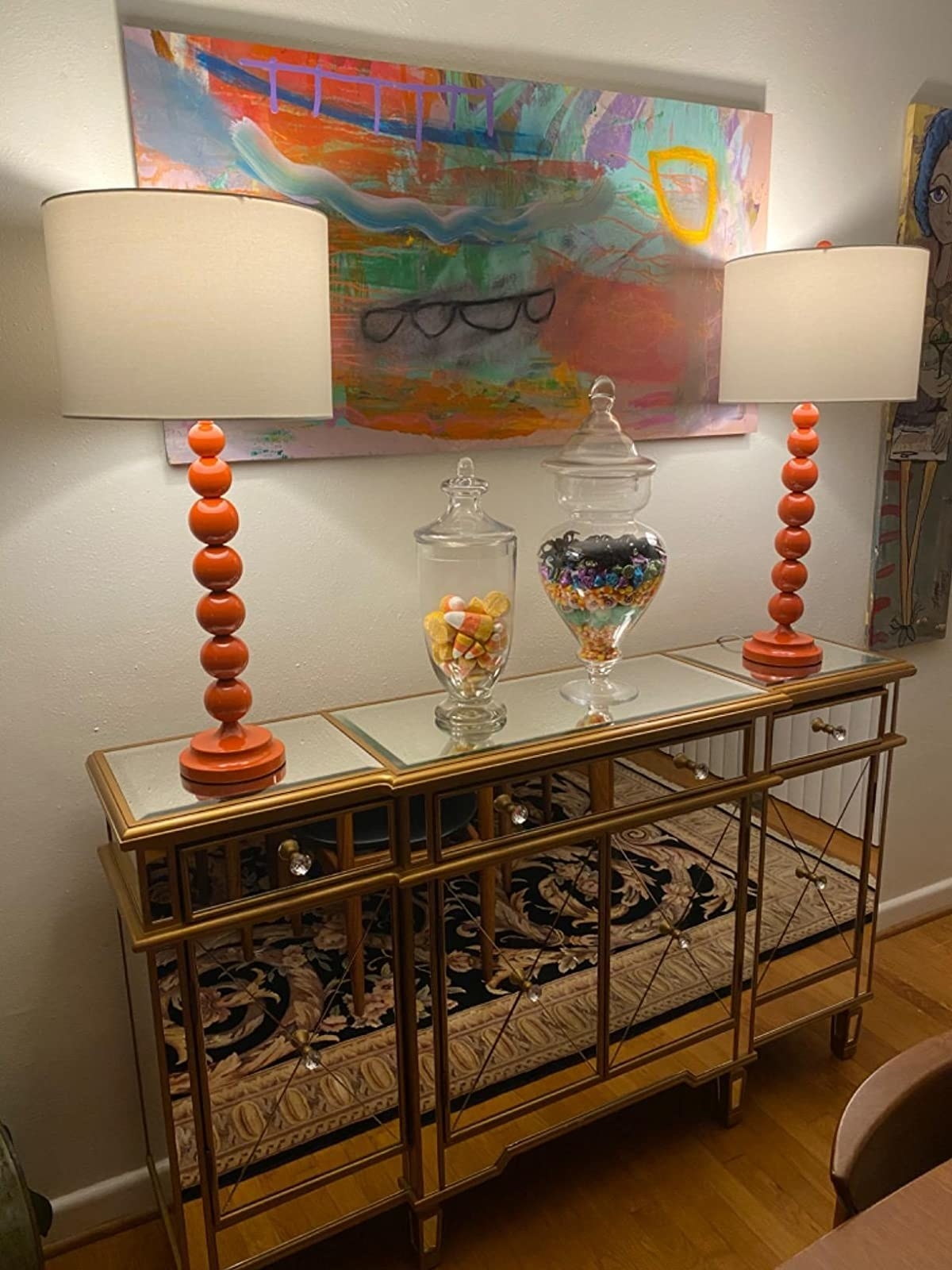 Reviewer's lamps sit on a mirrored console table