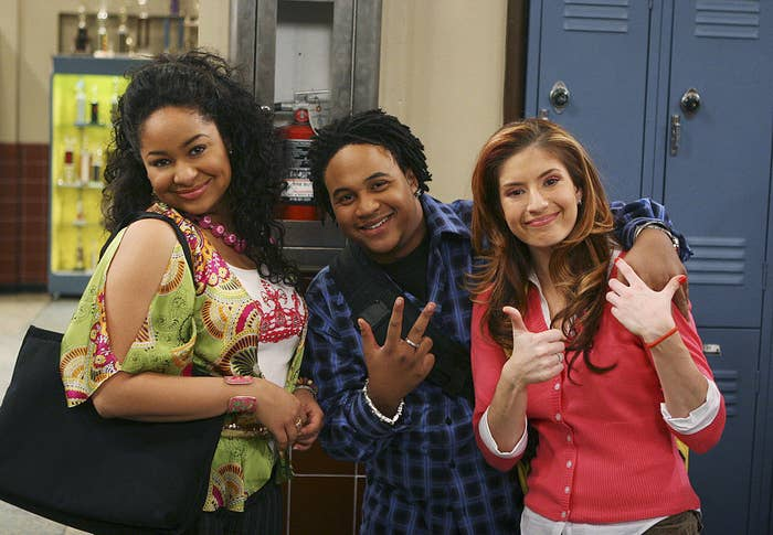 The cast of That's So Raven posing for a photo on set in front of lockers