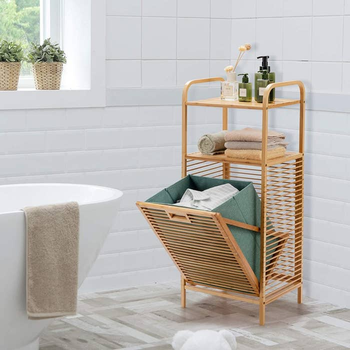 the tilt out laundry storage in a bathroom