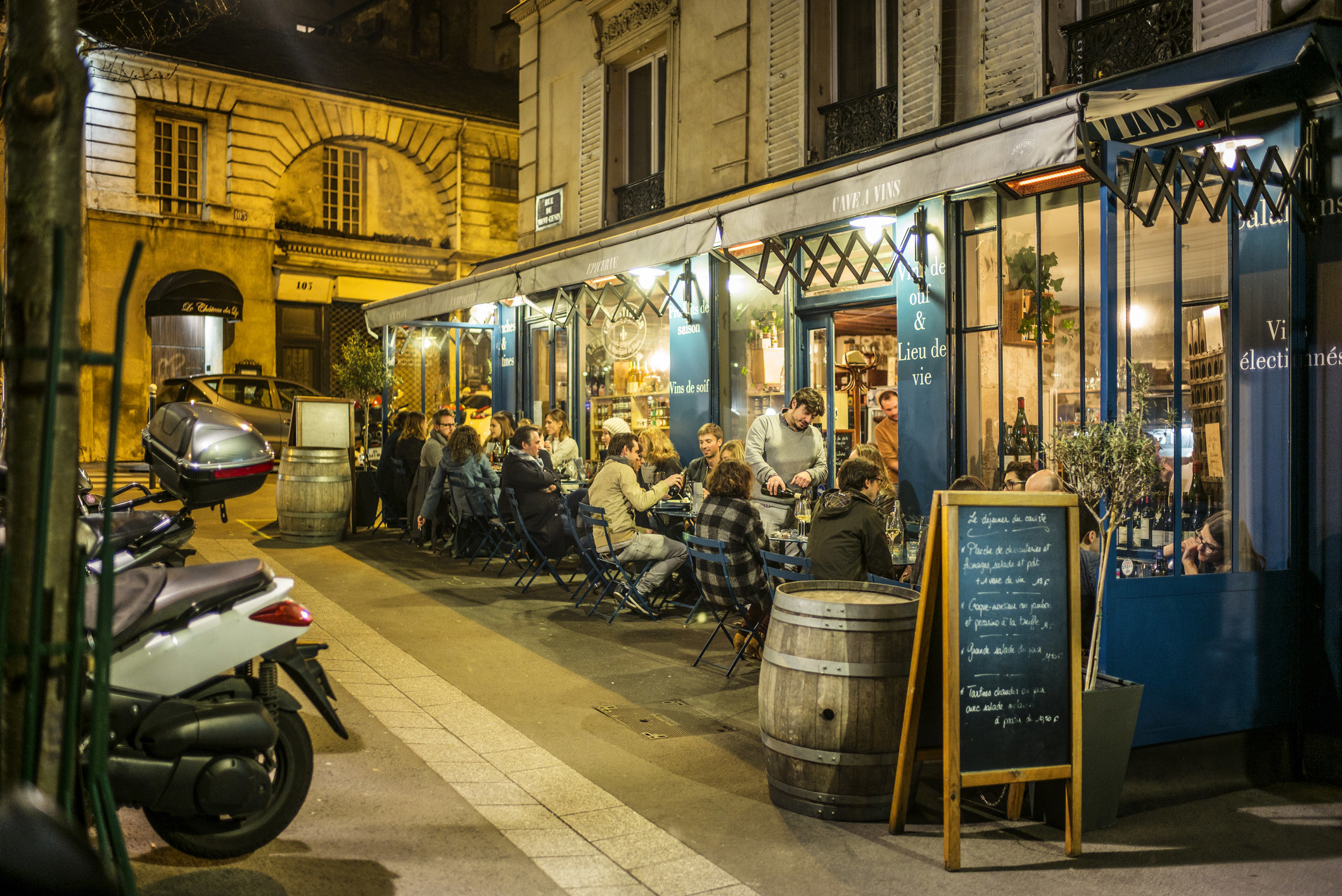 A busy cafe at night in Paris.