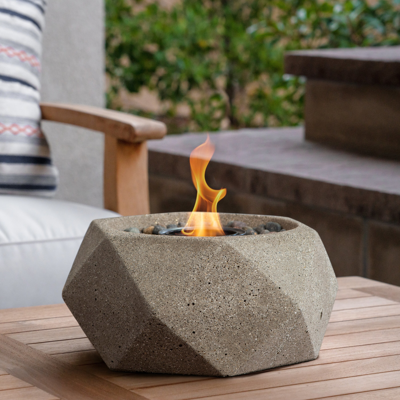 the sand colored geometric shaped fireplace