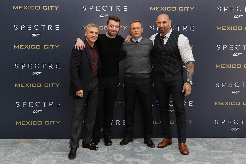 Sam Smith poses with the cast of Spectre