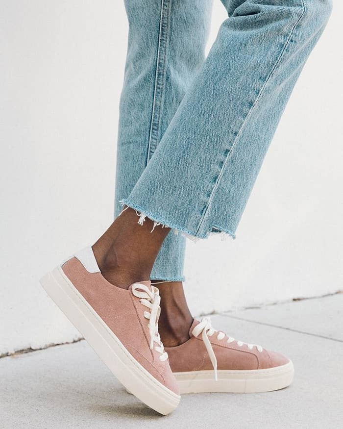 model wearing the pink suede sneakers with white platform sole