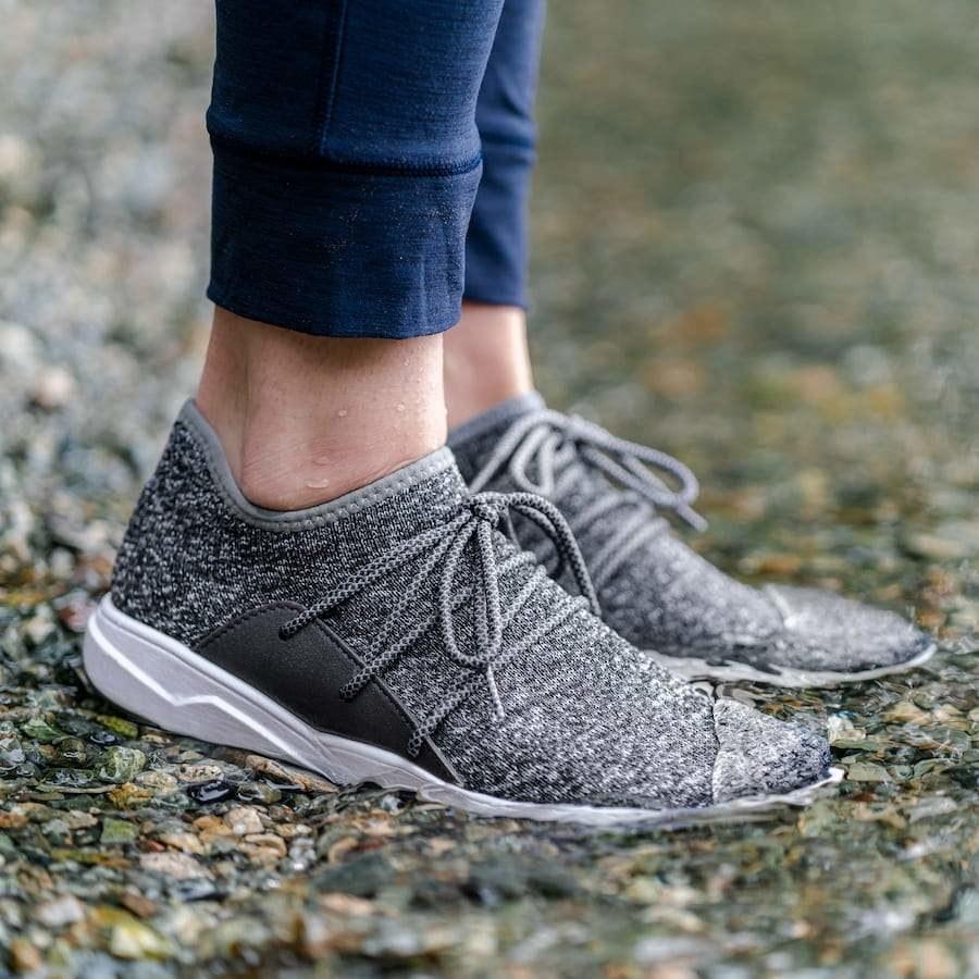 model wearing the grey knit sneakers