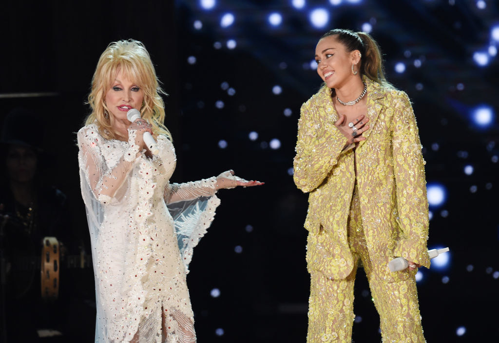 Dolly Parton and Miley Cyrus perform on stage together