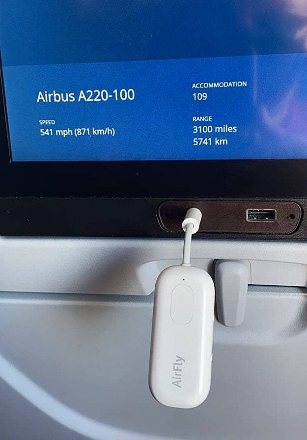 the AirFly Pro plugged into a screen on a plane