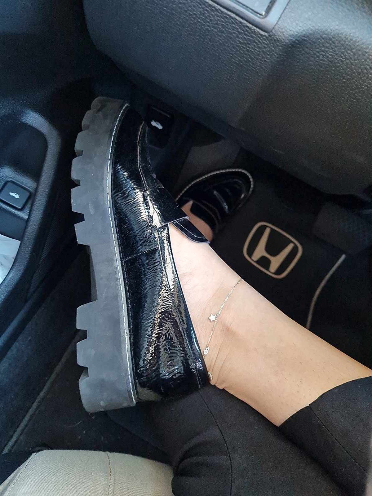 reviewer wearing the chunky loafers in shiny black