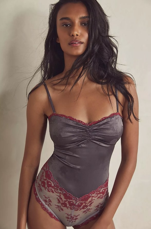 Muted purple silk bodysuit with red lace detailing