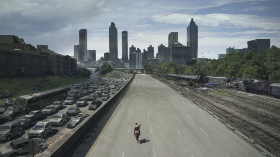 Rick riding down a highway into Atlanta