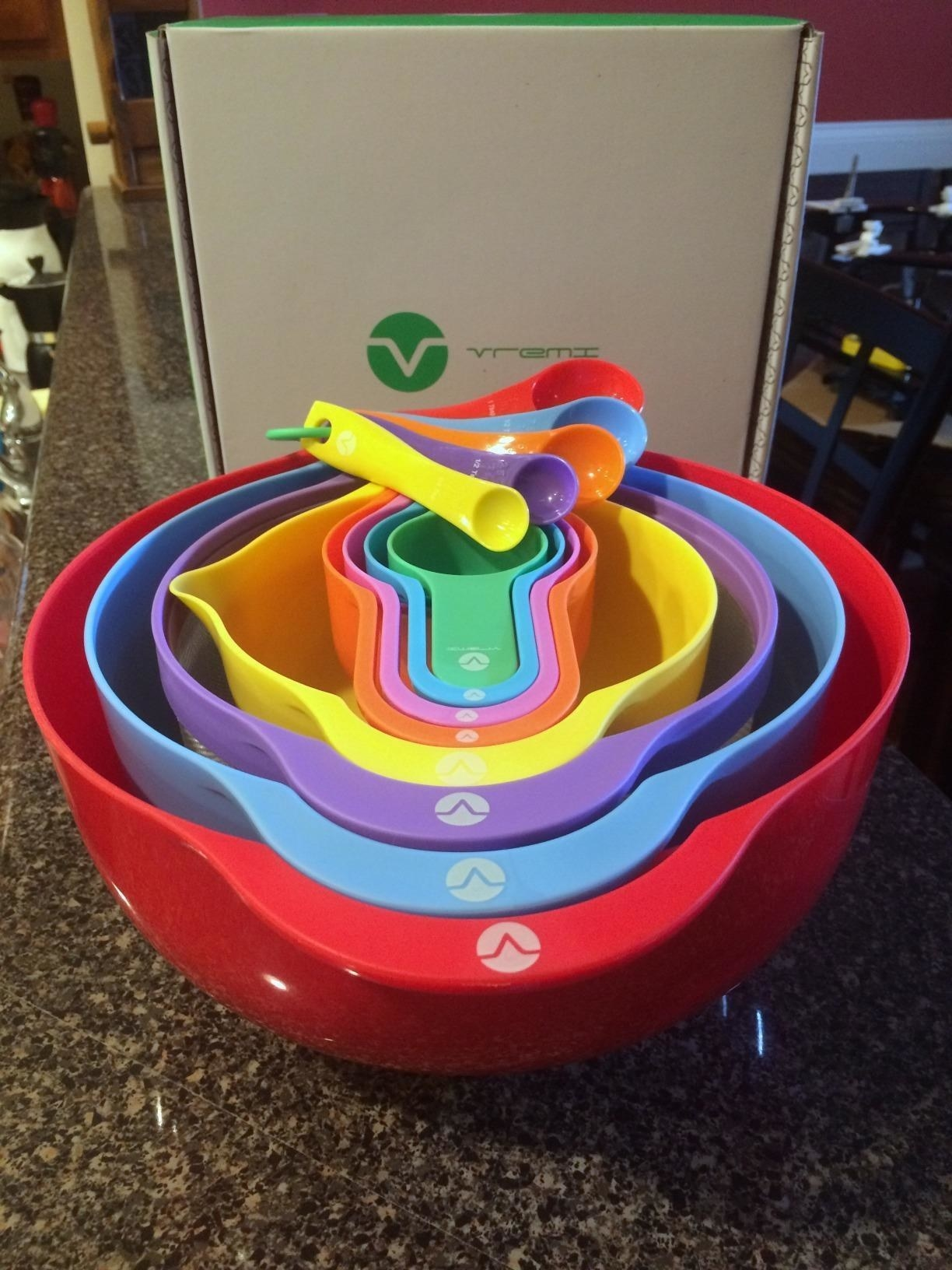 reviewer image of the complete 13 nesting mixing and measuring bowls on a kitchen counter