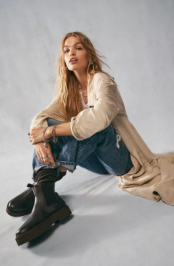 Model wearing back platform ankle boots