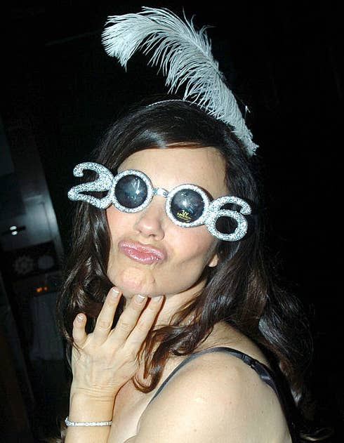 A person wearing a pair of sparkly sunglasses that spell out 2006