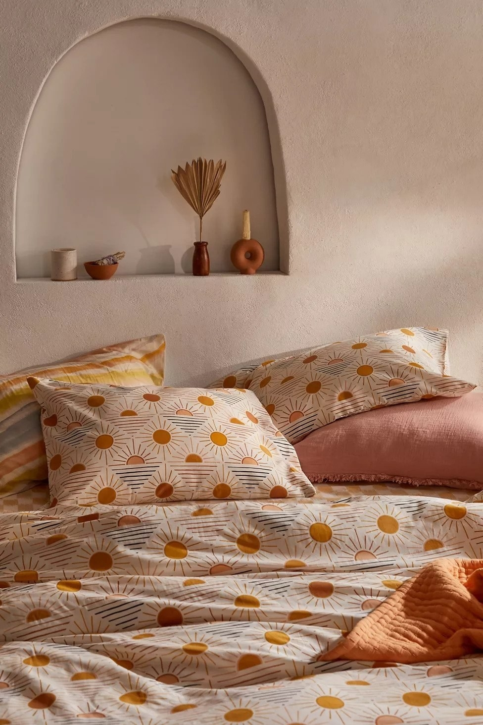 duvet cover and pillow shames with sun pattern throughout