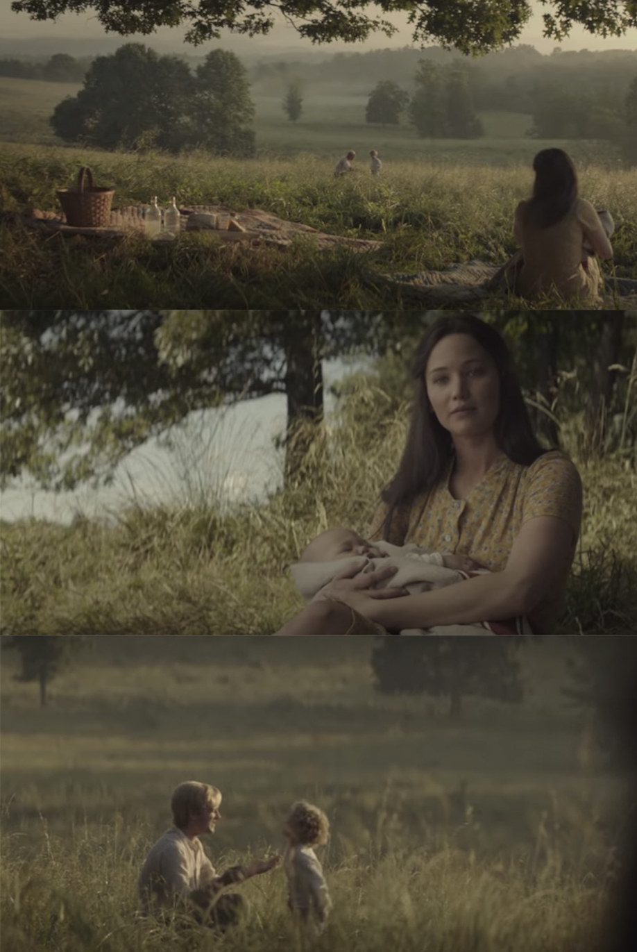 Katniss sits at a picnic with Peeta and their kids.