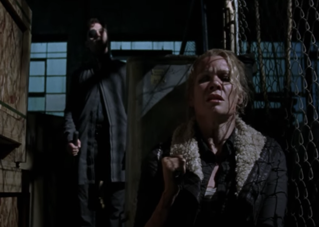 Andrea hiding with the Governor behind her