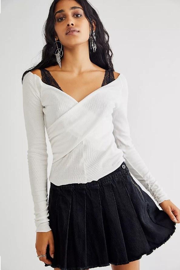 Model wearing black pleated skirt