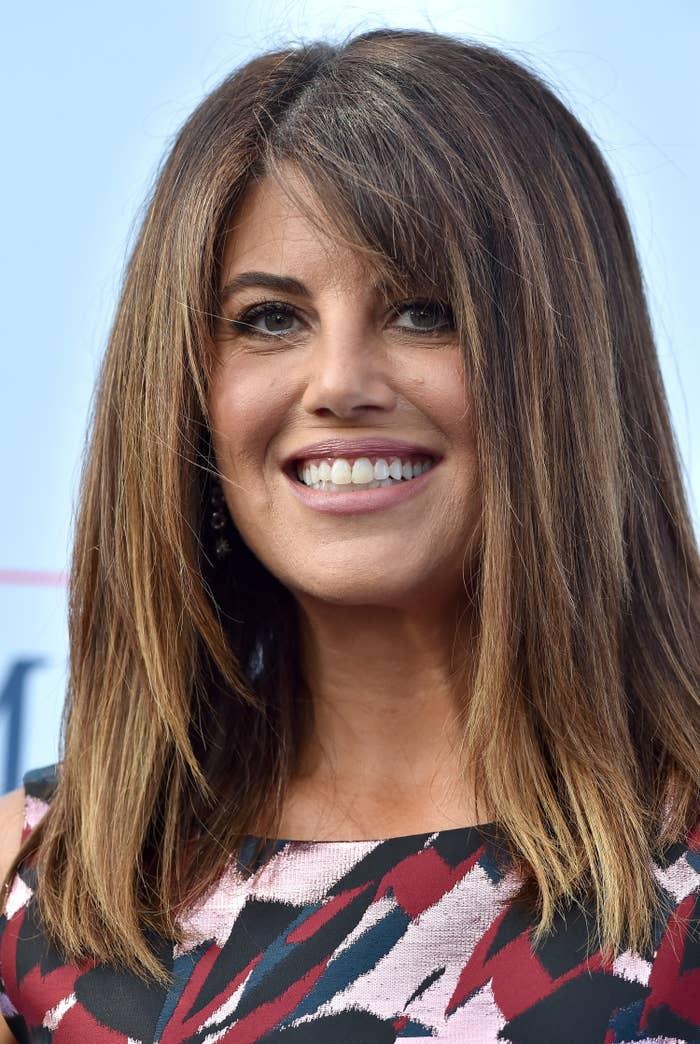 Monica Lewinsky attends a red carpet event and smiles for the camera