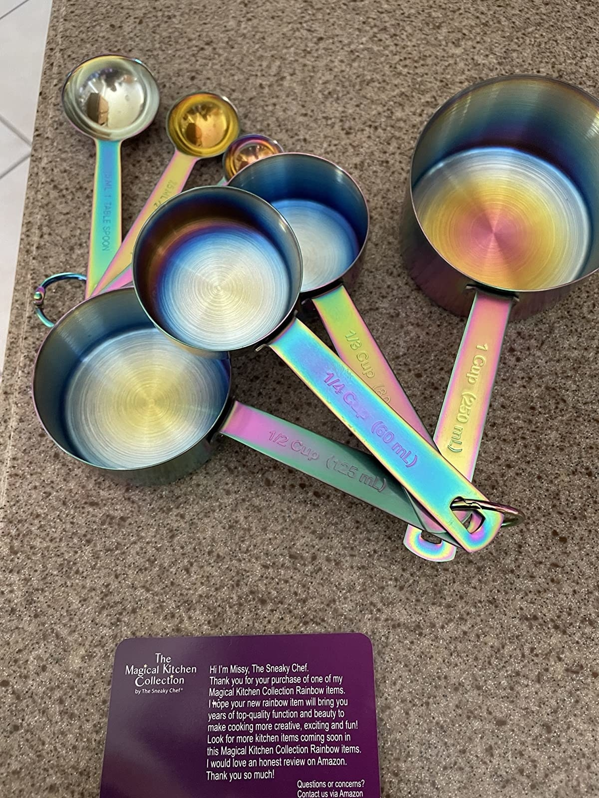 reviewer image of a set of iridescent measuring spoons
