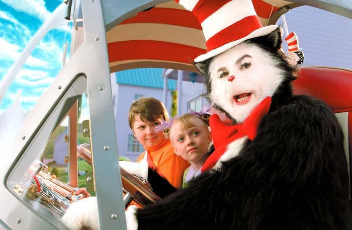 The Cat In The Hat escorting two children in his weird car